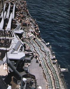USS New Mexico replenishing 14-inch ammo prior to the invasion of Guam, July 1944.