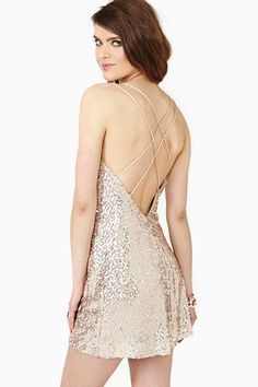 Magic Moment Dress - love the delicate criss-cross straps over the open back, love the flirty cut on the skirt.