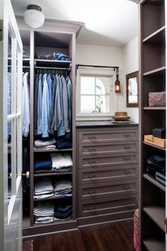 Built In Storage Fixtures Provide Maximum Storage In This Menu0027s Walk In  Closet.