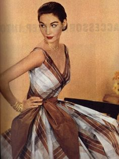 1950's dress of brown and white plaid. Love the shape and neckline of the dress, not necessarily the color/pattern