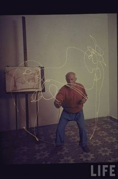 COLOUR PHOTOGRAPHS OF PICASSO PAINTING IN LIGHT, 1949 by Gjon Mili