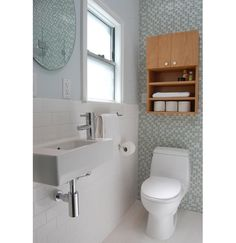 Small #bathroom designed spaciously. Check out the wall mounted sink - similar to Whitehaus model WH1-114