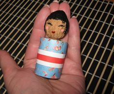 Kokeshi are Japanese dolls, originally from northern Japan. They are handmade from wood, have a simple trunk and an enlarged head with a few thin, painted lines to define the face. One characteristic of kokeshi Dolls is their lack of arms or legs.  So, with that being said.... today I'm going to show you how to make a Kokeshi Doll.  It will be a lot of fun.... almost as much fun as it will be showing to people the Kokeshi Doll you made yourself.  So, grab the materials needed and let'...