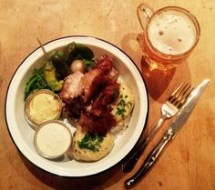 Roast shank of pork with potato dumplings, salad, pickles, horseradish cream & Bavarian mustard. Served with a Pilsner Urquell.