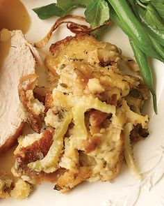Drying the bread cubes and cooking the vegetables a day in advance helps this stuffing come together quickly on Thanksgiving Day. This stuffing was created to accompany Herb-Rubbed Turkey.