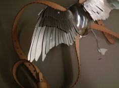 Steel wings, leather harness. I am always concerned about the sourcing of minerals, coming from an area and people exploited for minerals, and I am only open to the use of leather if it is a byproduct and not the reason for death. Aesthetically, this is beautiful.