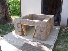 backyardbrickoven.com...Pouring the concrete slab and laying up the cinder block base for a wood fired brick pizza oven