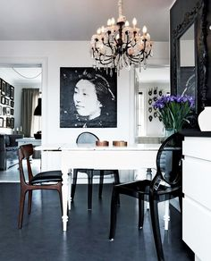 Mix seating styles at a dining table with crystal chandelier.