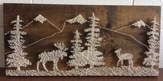 Moose and deer landscape string art. A beautiful piece to add to your home. Check out my Etsy shop NailedITCA for more work that's available.
