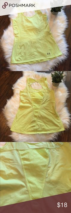 •Under Armour• Yellow Tank Under Armour Canary Yellow Workout Tank in Good Used Condition. The back is adorable with a cut out and a see through pattern. Please see pictures of sticking on the front. Under Armour Tops Tank Tops