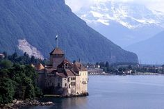 "Schloss Chillon, Switzerland.   An island castle on the shore of Lake Geneva at the foot of the Alps and 3 km from Montreux. The oldest parts have not been definitively dated, but the first written record of the castle's existence is in 1160 or 1005, and it consists of 100 separate buildings that were gradually connected. ""Switzerland's most visited historic monument"" it has always inspired artists and writers, from Jean-Jacques Rousseau to Victor Hugo and Lord Byron, from Delacroix to…"
