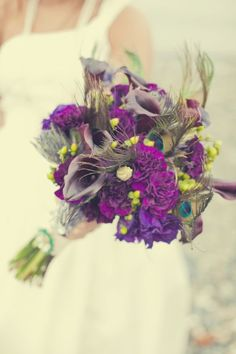 purple bouquet - hydrangeas, lilies, peacock feathers, carnations