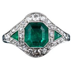 Art Deco Emerald and Diamond Ring | From a unique collection of vintage cocktail rings at http://www.1stdibs.com/jewelry/rings/cocktail-rings/