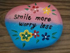 Painted rock Smile more worry less by PlaceForYou on Etsy, $9.99: