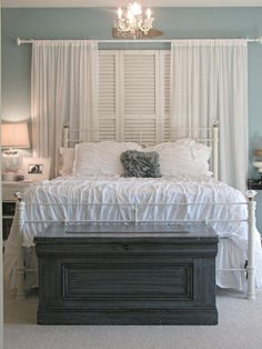 Bed in front of window - with shutters. For some reason I really like this. The colors maybe.....