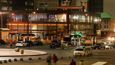 Stock Footage of Static timelapse at night of a busstation and parking area in Ghandi Square in the city centre of Johannesburg, South Africa during peak traffic time. Explore similar videos at Adobe Stock City Scene, Stock Video, Stock Footage, South Africa, Centre, Adobe, Busses, Night, Display