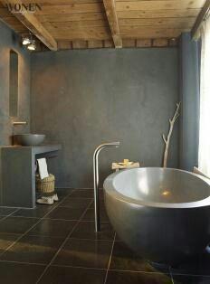 Combinatie van houten plafond met betonnen wand en grote tegels. Mooi.