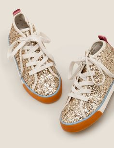High Tops - Pale Gold. High Tops. Ever feel like clicking those shoes together and taking off on an adventure? These high tops are ready and waiting, with contrast colours that make the heel and sole pop. They even come with a zip at the side for when there's no time to waste.