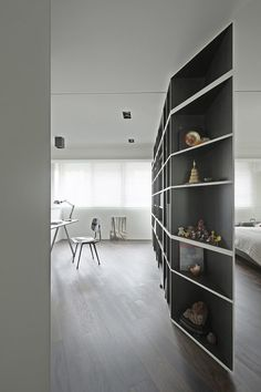 Designed by KC Design Studio, the Tsao residence consists of a rotating partition shelf that splits the flat into 4 rooms...or back into 1 open area.