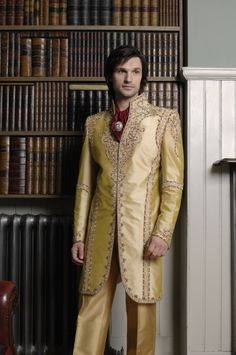 MF08 - three quarter length gold wedding suit with antique gold jardosi embroidery, red cravat and English trousers
