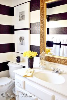 SUMMER HOME Black vase, gold mirror, and yellow towels from @HomeGoods make this bathroom look like summer  (sponsored pin)