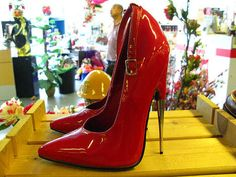 Killer Heels III - I think this is the most terrifying pair of shoes I have seen in my life. The razor thin heels of these red stilettos elevate perfectly perpendicul...