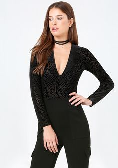 Fashion-forward bodysuit in burnout velvet with Victoriana-inspired motifs. Deep V-neck keeps it the center of attention. Long sleeves. Snap panty closure.