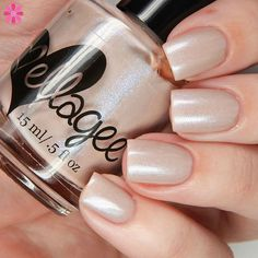 ellagee That's What She Said is a soft taupe grey creme with pink to blue shifting shimmer.. nail polish swatch / manicure