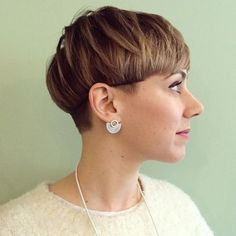 Very cute cut, not too short but a slight bowl shape from the ears around the back.