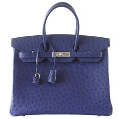 Rich exotic HERMES BIRKIN 35 Bleu Iris Ostrich is absolutely stunning. Ostrich 35 is the most rare skin and no orders are taken. Glows with Palladium hardware. NEW or NEVER WORN. Comes with lock, keys