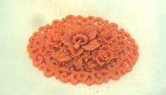 Lacy Flower Celluloid Vintage Pin.  Beautiful detail in the flowers and lacy edging.  Melon Colored Celluloid pin Measures 2 3/4 inches by 2 inches. Lovely condition.  Than... #vogueteam #teamlove #vtpassion #bitzofglitzu