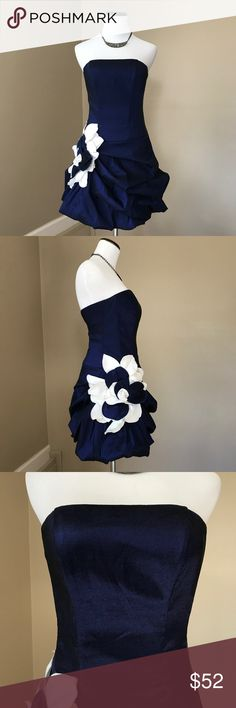 "Jessica McClintock Navy/White Strapless Mini Dress Midnight Blue Strapless Mini Dress. Satin blue and white flower on hip. Rouching around bottom half. Corset style on top half. 32"" bust with little stretch. 27"" waist. 26.5"" from top of bust to bottom of dress. Great condition. Prom dress, or new years dress. Jessica McClintock Dresses Prom"