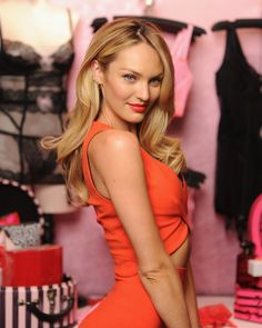 Candice showed off her classic Victoria's Secret curls at the Bombshell Day celebration. She paired the voluminous hairstyle with a bright orange lip (which is on trend right now).