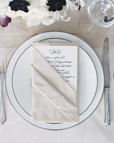 """Formal Menus: Place menu cards inside tuxedo-folded napkins. The Details: Menus, Crane & Co, 800-268-2281; silverware, James Robinson, 212-752-6166; """"Platinum"""" china, Jaspar Conran."""