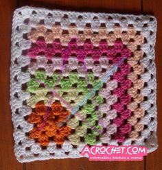 http://blog.acrochet.com/bebes/trabajamos-una-manta-con-aplicaciones-de-medio-granny-partiendo-desde-un-granny.html