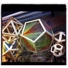 Art installation at Urban Outfitters in TO : geometric sculpture and string art hybrid!