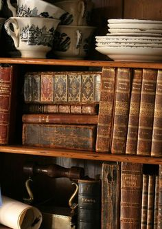 Lovely bookcase  and tea cups:)