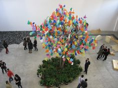 This large tree, decorated with beautiful colored plastic bags is the center piece in the gallery. The artist is Pascale Marthine Tayou, from Belgium. This installation is ironic. | Reference for installation art | Pinned Time: 20141126 07:54, Wed., Taipei Time.