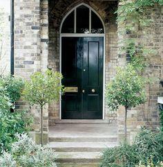 This lovely Victorian front door is Dulux Heritage Brunswick green