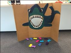 Chum Toss game, the shark was hand drawn and painted and the fish was made from felt and rice.