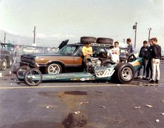 At Irwindale Raceway, CA ... a LONG time ago...  All they had was a station wagon push car, two extra tires. and closed metal trailer no paint. The Crew was the driver and the Owner and whatever guys made it to the race.  And you know the station wagon had to have good rims!  After...  all of them went to IN-N-OUT!!   YUM!