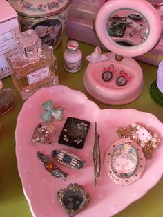 dresser or vanity top - vomit pink. old brooches, one has a Mid-cat on it.