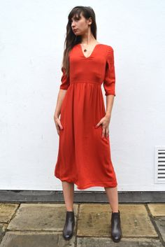 Bold red dress for autumn // Easy impact dress with an open rounded v-neck, pipe detailing, slim half sleeves with a single button closure and a thin tan leather waist belt to wear at the front or back. // #bold #bright #red #vneck #midi #dress #style #autumn #fall #fashion