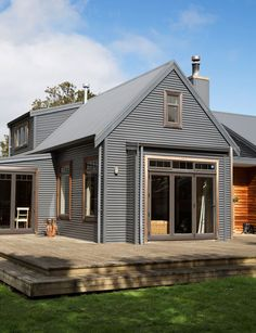 Brilliant Modern Farmhouse Exterior Designs Displaying Classic Comfort in Today Style - Modern house with new farmhouse exterior design pulling out country charm and warm welcoming display Imag House Cladding, House Siding, Farmhouse Architecture, Modern Farmhouse Exterior, Wood Architecture, Metal Building Homes, Building A House, Building Plans, Style At Home