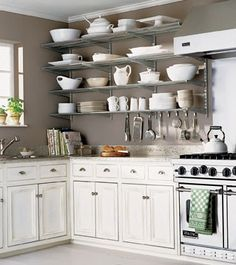 love the open shelves look - have tons of white PB serveware that would look fab like this...but with different shelves