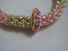 https://www.etsy.com/listing/224222044/sale-pink-and-gold-superduo-bracelet?ref=shop_home_active_4