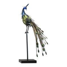 This Cyan Design sculpture, small Peacock Grandeur, lives up to its name. This natural sculpture is a beautiful blend of wood, metal and color. The entire structure is made of iron and wood. The industrialized elements are given a softened, more natural look through the use of bold jewel tones. The peacock has been adorned in shades of sapphire and emerald, completing the natural grand appeal. This one piece is enough to glam up any space.
