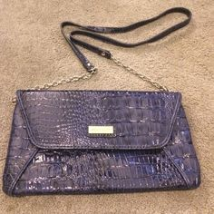 "NWOT Nine West patent crocodile print purse This great purse converts from a clutch to a shoulder purse in minutes. The 2nd photo shows the easy snaps to remove the chain strap. Purse is in great condition, never used.  Measurements 10"" x 6"" Nine West Bags Clutches & Wristlets"