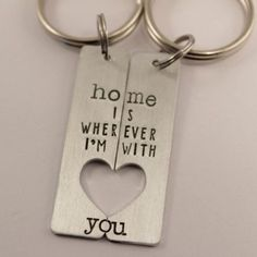 """This set of custom his and hers keychains are stamped with """"Home is wherever I'm with you."""" They are stamped while put together so each half will only EXACTLY line up with the other half, making this"""