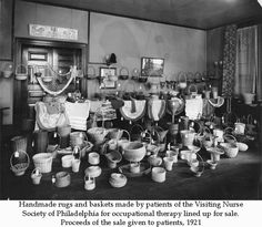 Handmade rugs and baskets made by patients of the Visiting Nurse Society of Philadelphia for occupational therapy lined up for sale. Proceeds of the sale given to patients, 1921. Image courtesy of the Barbara Bates Center for the Study of the History of Nursing.
